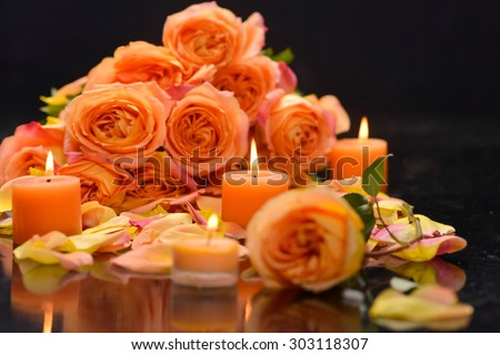 Rose, petals with candle â??black background - stock photo