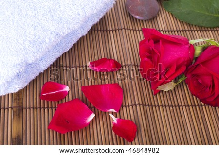 rose spa concept with towels and rocks - stock photo