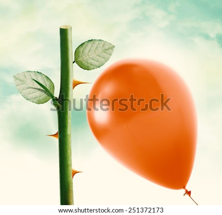 Rose thorn about to pop love heart balloon in vintage blue sky, clipping path and alpha channel included. - stock photo