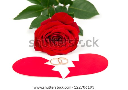 rose wedding rings and the two halves of heart isolated - stock photo