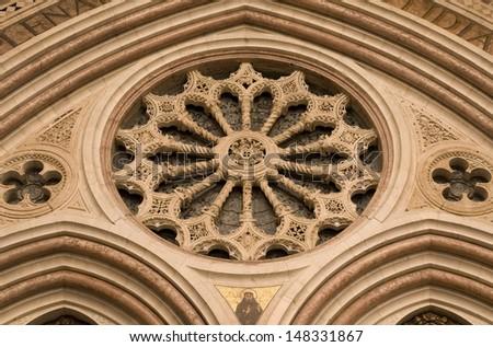 Rose window. Basilica of San Francesco. Assisi, Umbria, Italy. - stock photo