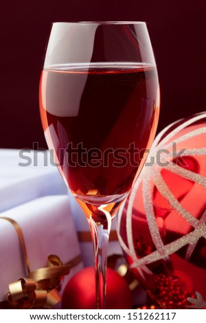 rose wine and Christmas decoration against color background  - stock photo