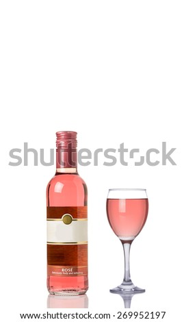 Rose Wine Bottle and a Full Glass Isolated on a White Background.  - stock photo