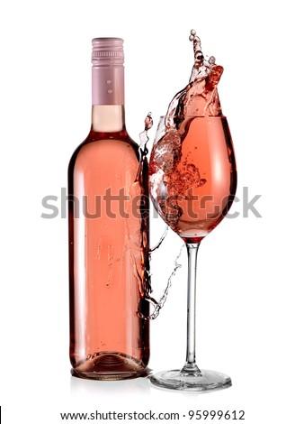 Rose wine bottle and a full glass splash - stock photo