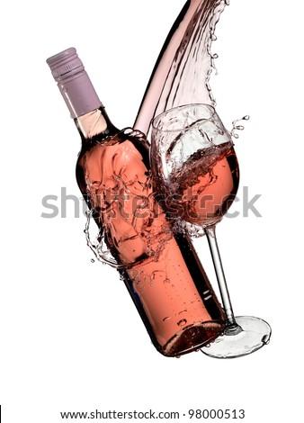 Rose wine bottle and glass splash - stock photo