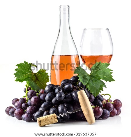 Rose wine bottle, wineglass, grapes, and corkscrew. - stock photo