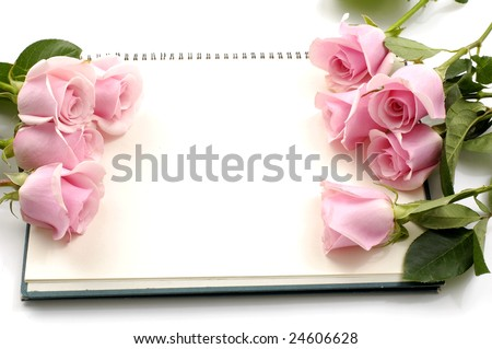Rose with a blank note - stock photo