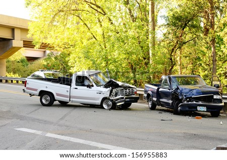 ROSEBURG, OR - AUGUST 29, 2013: Two vehicle head-on accident, caused by one truck failure to yield,  results in no injuries at a rural intersection in Roseburg, OR on August 29, 2013 - stock photo