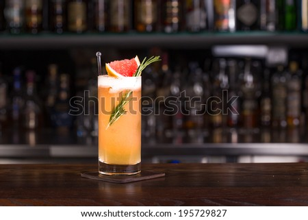 Rosemary cocktail on the bar - stock photo