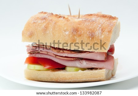 rosemary ham sandwich on baguette with fresh tomato and cucumber - stock photo