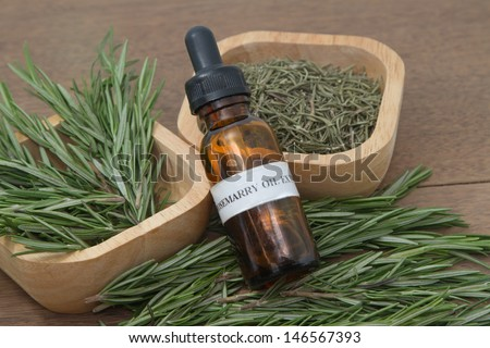 Rosemary herb and aromatherapy  essential oil dropper bottle ,for spa treatment - stock photo