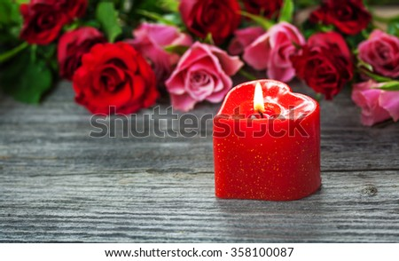 Roses and a Candle - stock photo
