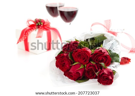 Roses and gift. Isolated on white background. - stock photo