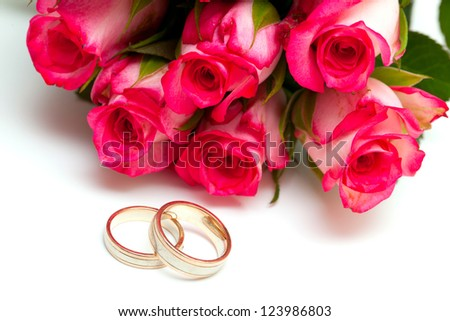 roses and wedding rings - stock photo