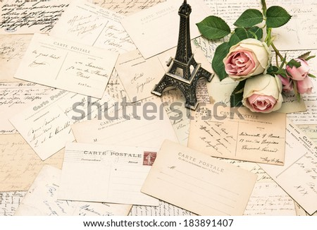 roses, antique french postcards and souvenir Eiffel Tower from Paris. nostalgic sentimental background - stock photo