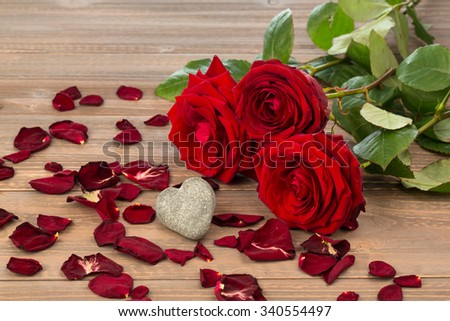 roses as a gift and surprise to a feast. symbol photo for birthday, mother's day, love, valentine's day - stock photo