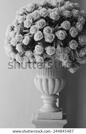 Roses bouquet at marble pole black and white version - stock photo