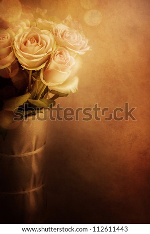 Roses in a vase. Vintage shot - stock photo