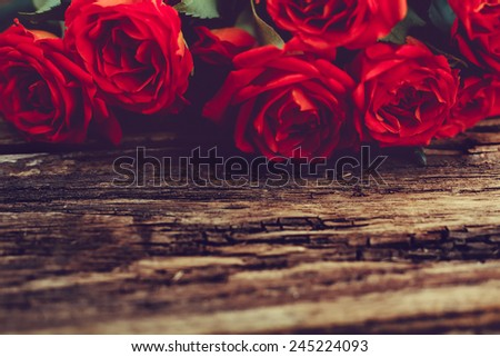 Roses on old wooden board, Valentines Day background, wedding day - stock photo