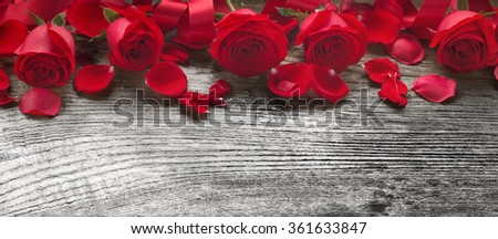 Roses on rustic wooden board,Valentines Day background. - stock photo