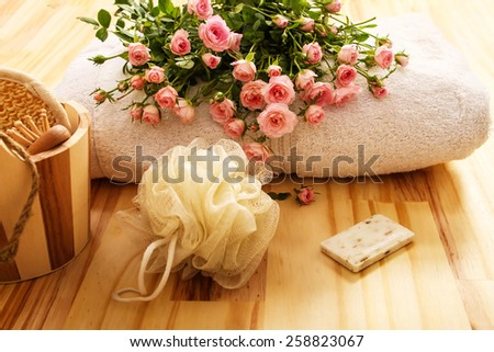 Roses, towels and spa accessories  - stock photo