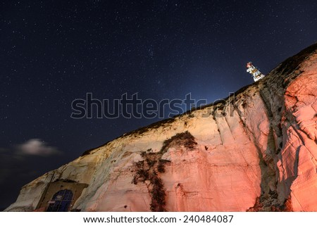 Rosh HaNikra is a geologic formation in Israel, located on the coast of the Mediterranean Sea, in the Western Galilee. It is a white chalk cliff face which opens up into spectacular grottos. - stock photo