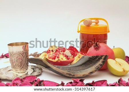 rosh hashanah (jewesh holiday) concept - shofar, torah book, honey,Kiddush cup ,apple and pomegranate over wooden table. traditional holiday symbols. - stock photo