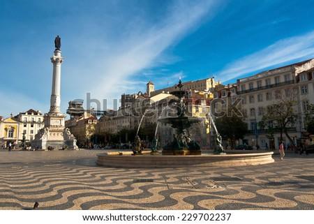 Rossio square and bronze fountain, Baixa, Lisbon, Portugal - stock photo