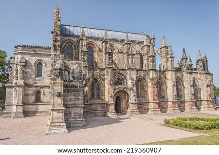 ROSSLYN, SCOTLAND - JULY 10: The 15th century Rosslyn chapel, Scotland on July 10, 2013. The building made famous from the Da Vinci Code book and movie.  - stock photo