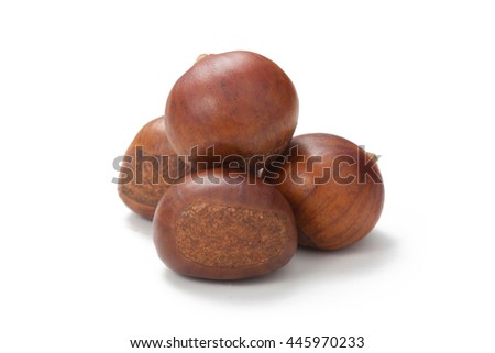 Rosted chestnuts isolated on white - stock photo