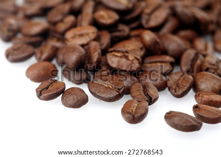 Rosted coffee grains on white backgorund - stock photo