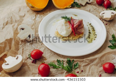 Rosti potato with bacon and poached egg on parchment background - stock photo