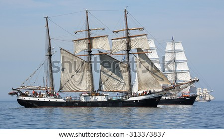 ROSTOCK, GERMANY - AUGUST 06, 2015 Old sailing ships Mercedes (NL) and Fridtjof Nansen (GER) sailing near Rostock on August 06, 2015 in the scope of the 25th Hanse-Sail Rostock, Germany - stock photo