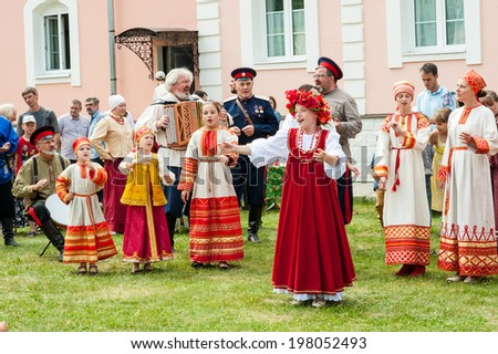 ROSTOV-ON-DON- JUNE 8: Don Cossack singing old songs with garmon, celebration of the Pentecost, Rostov-on-Don, Russia, June 08, 2014 - stock photo