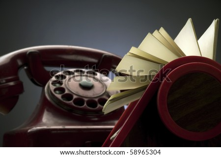 rotary card index with removable cards and an old red telephone - stock photo