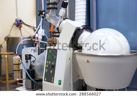 Rotary evaporator in chemical lab - stock photo