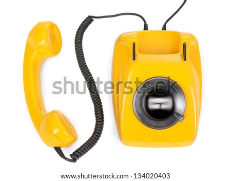 rotary phone with spinning dial on white background - stock photo