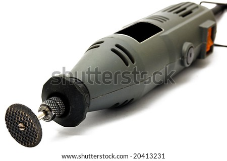 Rotary tools with accessory, focused on front side, isolated on white - stock photo