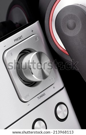 Rotary volume on the hi-fi system and headphones. - stock photo