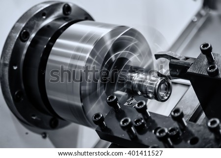 Rotating brilliant part of an automated lathe for machining of metal parts - stock photo