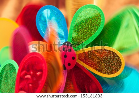 Rotating colored pinwheel - stock photo