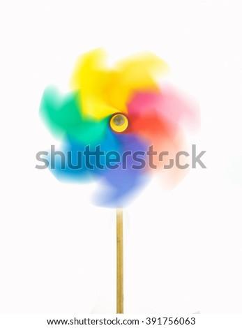 rotating colorful pinwheel,Isolated,White background. - stock photo