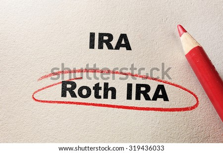 Roth IRA circled in red pencil, with IRA text                                - stock photo