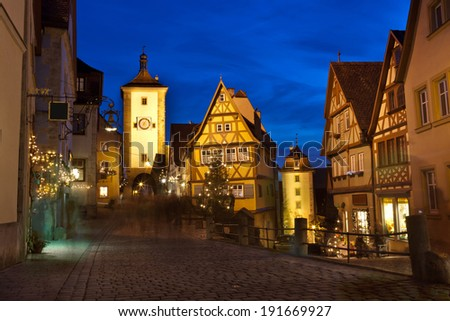 ROTHENBURG OB DER TAUBER, GERMANY - DECEMBER 22, 2013: Beautiful view by night of the historic town of Rothenburg ob der Tauber, Franconia, Bavaria, Germany - stock photo
