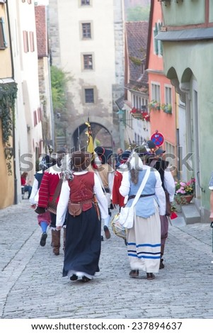"ROTHENBURG OB DER TAUBER, GERMANY - September 5: Performers of the annual medieval ""Imperial City Festival"", dressed in historical costumes on September 5, 2014 in Rothenburg ob der Tauber, Germany - stock photo"