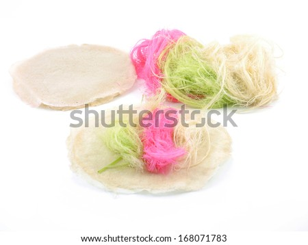 Roti Saimai (Cotton candy) thai sweet food isolate. - stock photo
