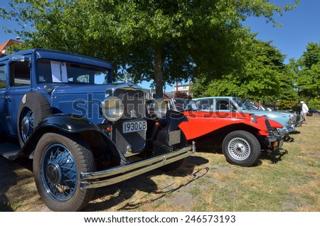 ROTORUA, NZL - JAN 15 2015:Visitors at Rotorua Vintage Car Club.In NZ there are more then 13,000 vintage classic cars in immaculate condition - stock photo