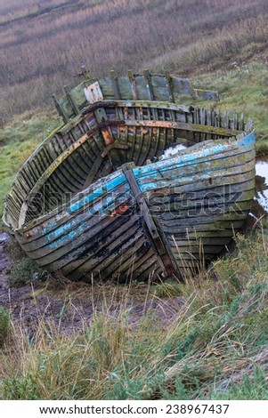 Rotten Abandoned Boat, Blakeney Point - stock photo
