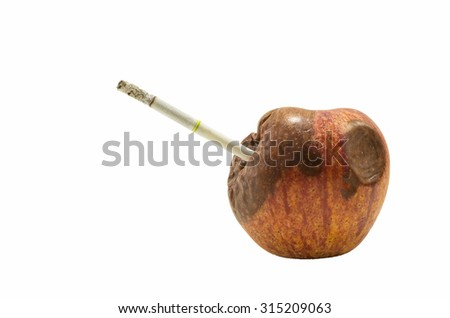 rotten apple with cigarette isolated on white background, quit smoking campaign - stock photo