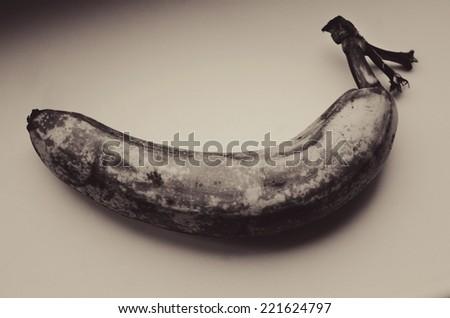 rotten banana in sepia tone - stock photo